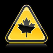 Yellow hazard warning sign with canadian maple leaf symbol on black background — Stock Vector