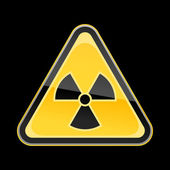 Yellow hazard warning sign with radiation symbol on black background — Stock Vector