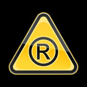 Yellow hazard warning sign with registered symbol on black background — Stock Vector