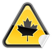 Sticker yellow hazard warning sign with canadian maple leaf symbol on white background — Stock Vector