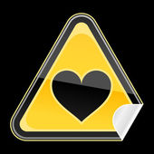 Yellow hazard warning sign with heart symbol and with reflection on black background — Stock Vector