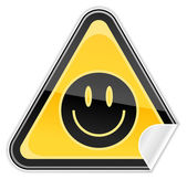 Sticker yellow hazard warning sign with smiley face symbol on white background — Stock Vector