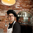 Pizza Chef standing in the kitchen working — Foto de Stock