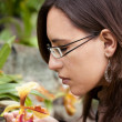 Smelling flower - Stock Photo