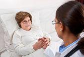Doctor comforting senior patient — Stock Photo