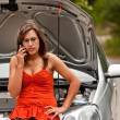 Broken Car - Young Woman Calls for Assistance - Stock Photo
