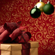 Christmas present with decorative xmas bubbles — Stock Photo #23710523