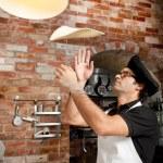 Постер, плакат: Pizza Chef playing with Pizza Dough