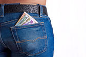 Money in Girls Jeans Back Pocket — Stock Photo