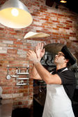 Pizza Chef playing with Pizza Dough — Stock Photo