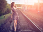 The girl on tracks — Stock Photo