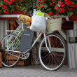 Vintage bicycle with basket — Stock Photo
