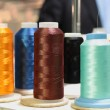 Sewing threads multicolored on spool — Stock Photo #38834779