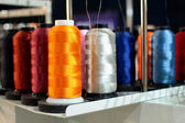Sewing threads multicolored on spool — Stock Photo