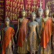 A group of buddha statues (standing) - Foto Stock