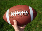 Football in Hand — Stockfoto