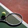 Tennis Ball with Racket on Court — Stock Photo