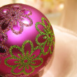 Closeup of pink christmas tree ball with decorative pattern — Stock Photo