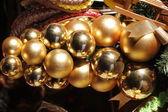 Decorative cluster of golden christmas balls — Stock Photo