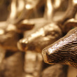 Heads of golden deer statuettes — Foto Stock