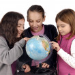 Girls looking at earth — Stock Photo