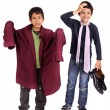 Boys dressing father's suit - Stock Photo