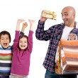 Adult man shopping christmas presents to kids - Stock Photo