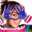 Stock Photo: Five year old girl with hands painted