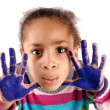 Five year old girl with hands painted - Стоковая фотография