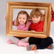 Boy and girl with frame — Stock Photo