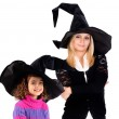 Young woman in witch costume — Stock Photo