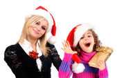 Mother and daughter in christmas hats — Stock Photo