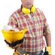 Constructor holding helmet - Stock Photo