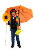 Boy posing with umbrella — Stock Photo