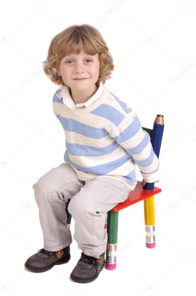 Little Boy Sitting In A Chair Stock Photo 169 Verkoka