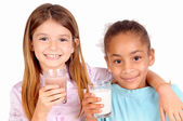 Littles girls with milk — Stock Photo