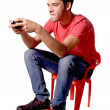 Teenage boy playing video games — Stock Photo