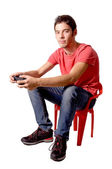 Teenage boy playing video games — Stok fotoğraf