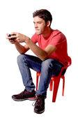 Teenage boy playing video games — Stock Photo