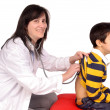 Female doctor with boy — Stock Photo