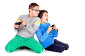Little boys playing videogames — Stock Photo