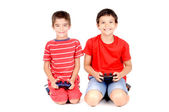Boys playing video games — Stock Photo