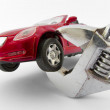 Car trapped by monkey wrench — Stock Photo