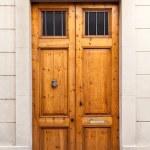 Double wooden door with knocker — Stock Photo #23864699