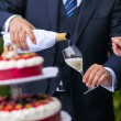 Champagne and wedding cake — Stock Photo