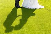 Bride and groom kiss — Stock Photo
