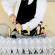 Waiter opening a bottle of white wine — Stock Photo #24222837