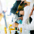 Waiter pouring champagne — Stock Photo #24222873