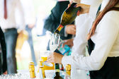 Waiter pouring champagne — Stock Photo