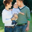 Foto Stock: Family on the park